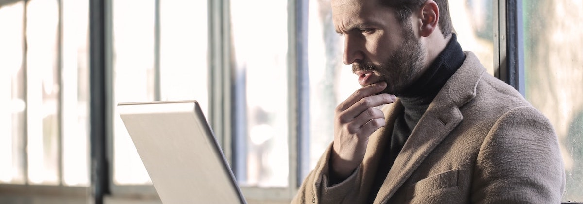 man-wearing-brown-jacket-and-using-grey-laptop-874242.jpg